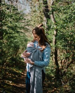 mom with baby in carrier sling